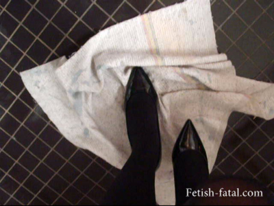 48803 - The model scrubs the floor with her high-heeled shoes