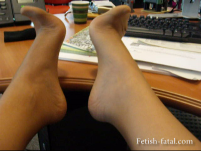 49955 - She shows off her feet under her desk with nylon stockings then repettos