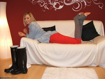 posing in rubber boots and cuffs