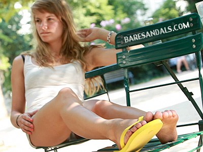 27477 - Caro in yellow flip flops