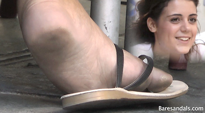 44749 - Beautiful black haired girl in sandals under the table