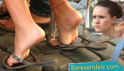 Italian girl with playful flip flops under the cafe table - 4041
